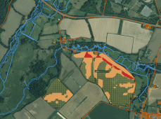 Figure 8: Finer grained risk map derived from Hampshire data (20m elevation model, field boundaries from aerial imagery). Moderate risk shown in orange, greatest risk in red. Hashed areas are oilseed rape fields. [Contains Ordnance Survey data © Crown copyright and database right 2014. Contains public sector information licensed under the Open Government Licence v2.0].