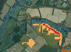 Figure 7: Hampshire open aerial imagery and Landsat derived risk (orange = moderate risk, red = greatest risk). Hashed areas are oilseed rape fields. [Contains Ordnance Survey data © Crown copyright and database right 2014. Contains public sector information licensed under the Open Government Licence v2.0].